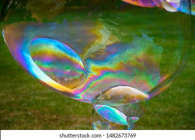 giant soapbubbles rainbow color, birthday party fun