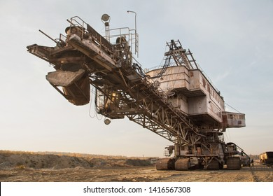 Giant stacker. Bucket chain excavator in a sand quarry. Bulk material handling