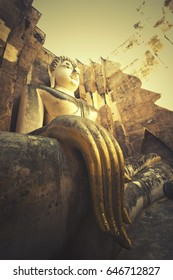 Giant statue of Buddha with retro filter effect in Wat Si Chum At Sukhothai historical Park, Sukhothai province , Thailand  [Vintage Filter]