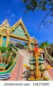 Giant statue  and entrance gate at Kao Rang temple, Phuket, Thailand