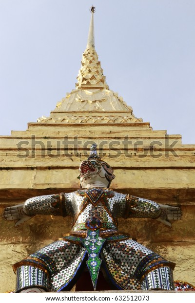 giant statues and golden pagoda