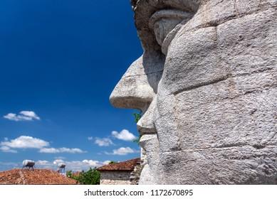 Giant stone head of Constantine the Great at Berat Castle in Berat, Albania