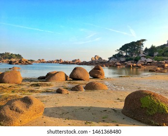 Giant stones of pink granite on the beach in the Breton town of Perros Guirec, Bretagne, France.
