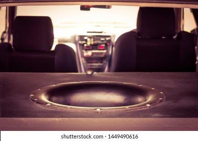 Giant Subwoofer Sound Speaker in the Trunk. Blurred Car Interior.