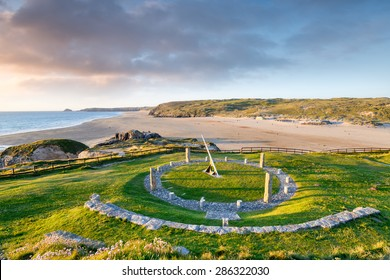 A giant sundial above the beach at Perranporth in Cornwall