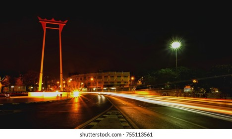 Giant Swing, a cultural landmark of Bangkok Thailand, the dense traffic, the light is a beam line.