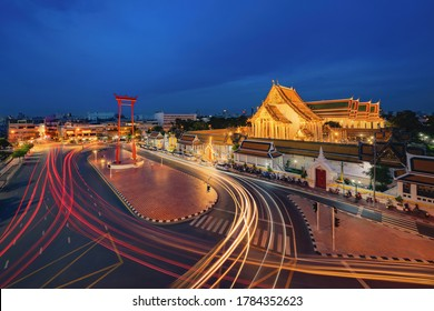 The Giant Swing or Sao Ching Cha monument with Wat Suthat temple at night in old town, Bangkok City, Thailand. Landmark tourist attraction. Thai architecture with travel trip concept.