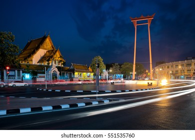 Giant Swing with Wat Suthat Temple at night in Bangkok, Thailand.