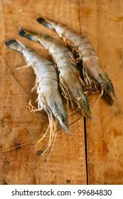 giant tiger raw shrimps prawns  on wood case, macro