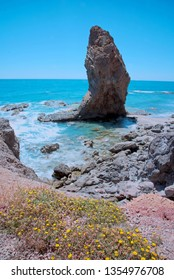 Giant tip-shaped rock on the beach of Sombrerico, Mojacar