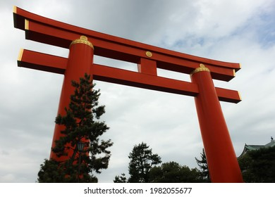 Giant torii of the Heian Jingu Shrine on a cloudy day in downtown Kyoto