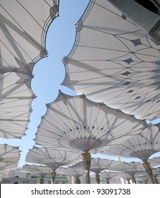 Giant umbrellas at Nabawi Mosque compound in Medina, Kingdom of Saudi Arabia. Nabawi mosque is the second holiest mosque in Islam.