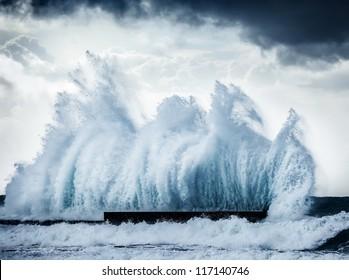 Giant wave splash, beautiful dark dramatic seascape