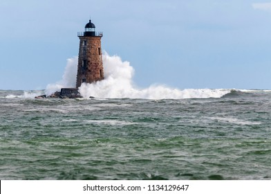 A giant wave from an unusual high tide breaks around Whaleback lighthouse in Maine.