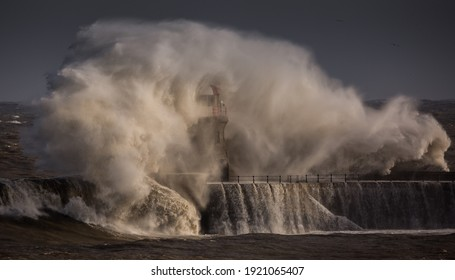 Giant waves batter the 15metre tall lighthouse which guards the south pier at the mouth of the Tyne at South Shields, England