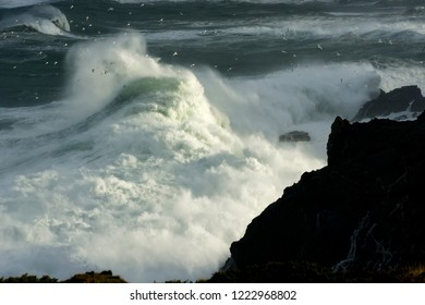 giant waves breaking on cliffs on a stormy day in atlantic coast , Coruna , Spain