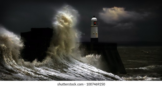 Giant waves crash against Porthcawl lighthouse in Wales during a storm