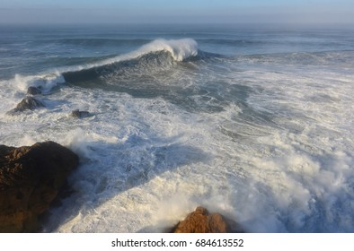 Giant waves in winter, in Nazare, Portugal.