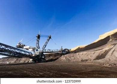 Giant wheel of bucket wheel excavator in a brown coal open pit.