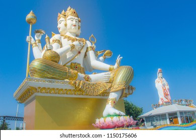 Giant white Brahma statue with blue sky background. Brahma is the Hindu Creator god. He is also known as the Grandfather and supreme in the triad of great Hindu gods which includes Shiva and Vishnu.