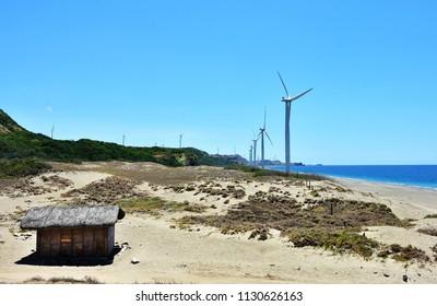 Giant windmills along seashore