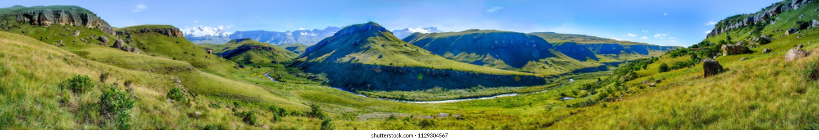 Giants Castle South Africa scenic green Drakensberg mountains- beautiful, idyllic and impressive green ultra wide color panorama with sunny blue sky,fairy tale like, mountains,valley,creek,wanderlust