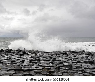 Giants Causeway and Causeway Coast, County Antrim  - Ireland - Waves Splashing Over Interlocking Hexagon Shaped Rocks