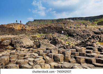 Giant's Causeway, Northern Ireland - JUN 5: thousands of tourists visiting this World Heritage Site on Jun 5, 2016 in Antrim, Northern Ireland. 40 000 basalt columns from ancient volcanic eruption