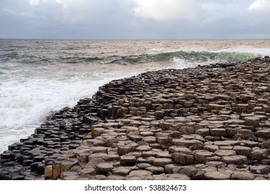 Giant's Causeway is a tourist hot spot in the Northern Ireland. The area is a geological curiosity built up by interlocking basalt columns.