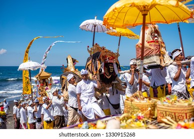Gianyar, Bali / Indonesia : April 17, 2016 : Melasti ceremony before balinese new year Nyepi in Masceti Beach.
