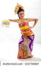Gianyar, Bali / Indonesia - August 2012 : Portrait of  Balinese Woman Dancer. Balinese traditional dress isolated with white background