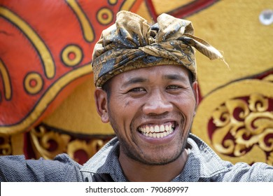 GIANYAR, BALI, INDONESIA - JANUARY 08, 2018 : Unknown Balinese man participates in a street ceremony, during a pre-election rally, the Indonesian Democratic Party of Struggle in island Bali, Indonesia