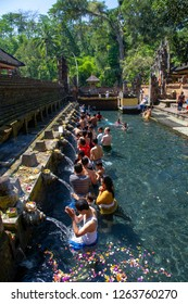 Gianyar, Bali / Indonesia - September 1, 2012 : Purification ritual at Tirta Empul Temple pool.