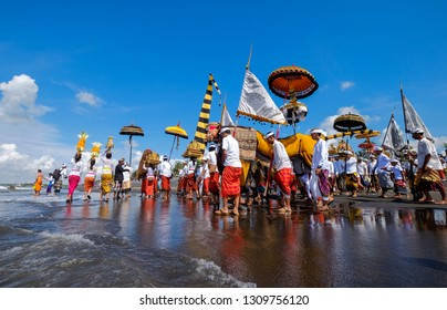 Gianyar, Bali, Indonesia-March 14th 2018 :Hindus carry out a Melasti ceremony before the Nyepi of Bali's new year on Masceti Beach