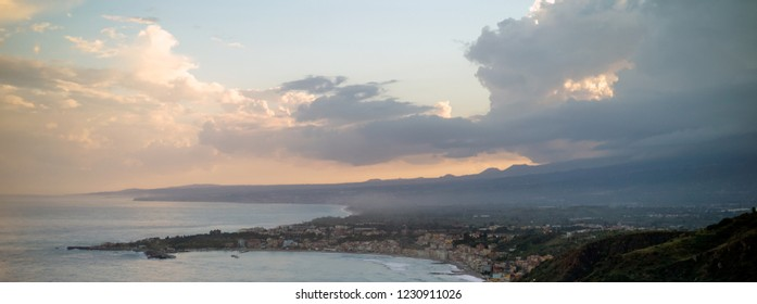 Giardini Naxos aerial view and clowds over Etna slope, Sicily, Italy