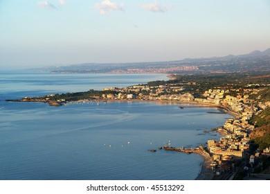 Giardini-Naxos bay under volcano Etna, famous holiday resort, Sicily