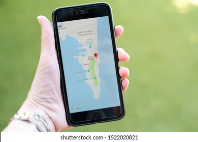 Gibraltar 04 October 2019: Hand holding an iphone with the Google maps app open showing a map of Gibraltar