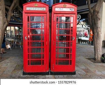 Gibraltar - 10 09 2019: Two traditional red telephone boxes in the Main Street in the center of Gibraltar