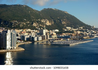 GIBRALTAR - MAY 9: Gibraltar is a British Overseas Territory on Spain's south coast. It' is dominated by the Rock of Gibraltar which overlooks a natural harbour in Gibraltar, May 9, 2018