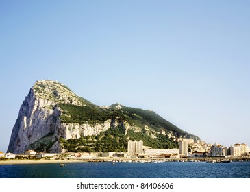 Gibraltar on a sunny day seen from across the bay.