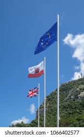 GIBRALTAR, SPAIN: 12-MAY 2017: The EU flag, The Flag of Gibraltar and the Union Jack flag on the Rock of Gibraltar in May 2017.