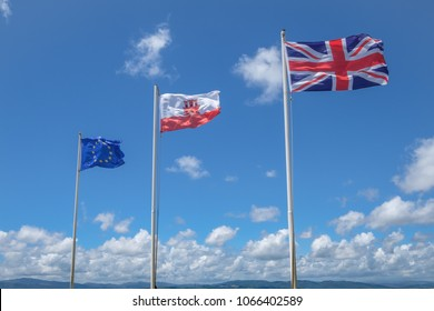 GIBRALTAR, SPAIN: 12-MAY 2017: The EU flag, The Flag of Gibralta and the Union Jack flag on the Rock of Gibraltar in May 2017.