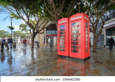 GIBRALTAR, SPAIN: 12-MAY 2017: Two traditional British phone boxes in Gibraltar on a rainy day in May 2017.