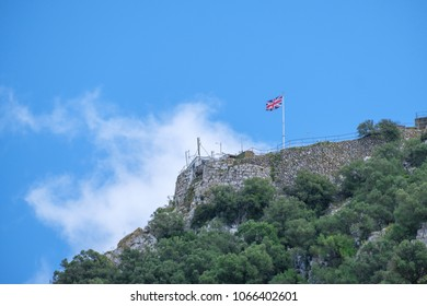 GIBRALTAR, SPAIN: 12-MAY 2017: Union Jack flag at the top of the Rock of Gibraltar in May, 2017.