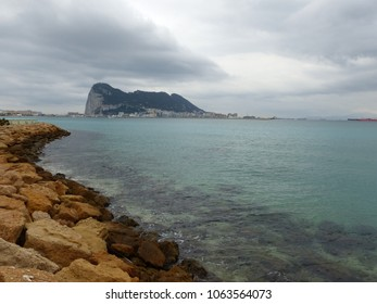 Gibraltar, Spain / Spain - March 2018: Gibraltar rock and city seen from Spain