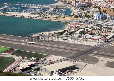 GIBRALTAR, UK - 15 SEPTEMBER 2017: British Airways airbus landed at the airport of Gibraltar. Gibraltar airport runway and La Linea de la Concepcion in Spain.Editorial use only.