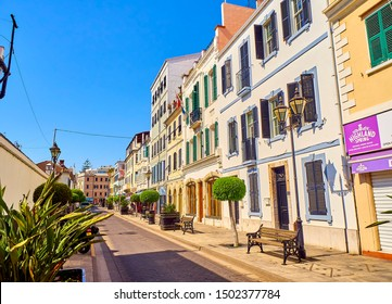 Gibraltar, UK - June 29, 2019. Typical buildings of Gibraltar downtown. View from Main street. Gibraltar. British Overseas Territory. UK.