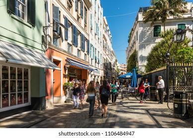 Gibraltar, UK - May 18, 2017: Tourists visit Main Street, the main arterial street in the British overseas territory of Gibraltar, United Kingdom, Western Europe.