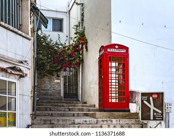 GIBRALTAR, UNITED KINGDOM - 08 JUNE, 2018.  Street of Gibraltar. Red Call-box.