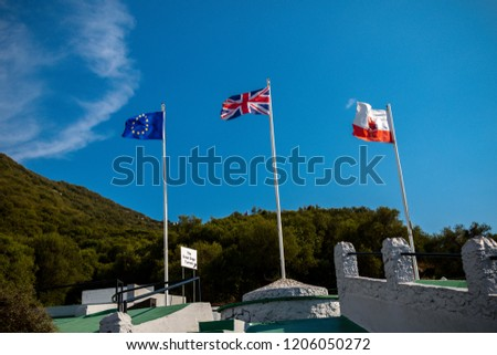 Gibraltar, United Kingdom, 1st October 2018:- The flags of Gibraltar, United Kingdom and the EU flying in Gibraltar. Gibraltar is a British Overseas Territory located on the southern tip of Spain.